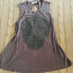 Skull Twist Back Tank Skull Twist Back Tank  NWOT Skull design on front Twisted back design Lightweight fabric 2 Small 2 Medium 1 Large available  ⭐️Price is firm⭐️ Tops Tank Tops