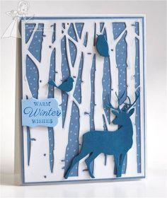 hanmade card ... gorgeous winter scene in blue and white ... BirchTreeCuttingPlate .... die cut trees, bird, owl and deer ... like the look of falling snow in the background ,,, Taylored Expressions