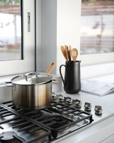 Accessorizing with items that someone uses everyday creates a story of truth in a photo like this stove and kitchenware.