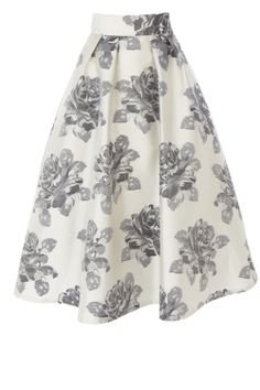 A show stopping catwalk inspired midi skirt with statement volume. The Rita skirt features subtle pleats at the waist that create a modern look whilst a tulle under skirt creates exaggerated fullness and dramatic flaring. Oozing vintage appeal, the skirt is adorned in metallic floral embroidery making for the perfect finishing touch. Fully lined this skirt is fitted with an invisible back zip fastening. Skirt length from waist to hem is 35.5 inches/ 90 cm. To the complete the look, wear with…
