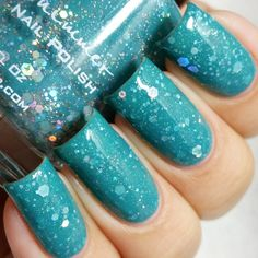 Home Surf. A muted teal crelly with silver holographic glitters in several sizes.
