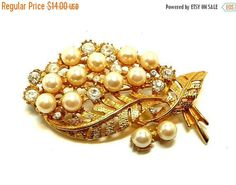 New Listings Daily - Follow Us for UpDates -  ❘❘❙❙❚❚ March Madness SALE ❚❚❙❙❘❘     Rhinestone Leaf Brooch - Simulated Pearls and Rhinestones -  Goldtone Leaves offered by  TheJewelSeeker  This is a great brooch with si... #vintage #jewelry #teamlove #etsyretwt #ecochic #thejewelseeker