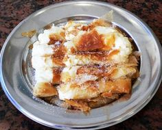 Greek pastries; Bougatsa is served for breakfast in Crete. Any place that serves bougatsa for breakfast is a great place for us!