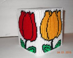 This cute tissue box cover will look nice in any room  Made by Lori