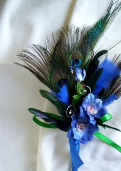 Peacock Feather Bouquet Royal Blue Peacock Weddings corsages, not for the men. ladies like mothers grandmothers etc