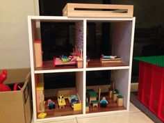 Dolls house made from 4 cube kmart storage unit, sticky tiles from Bunnings & craft card wallpaper from Spotlight!
