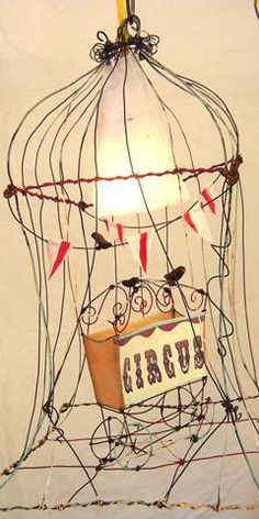 artist: tammy smith hanging lamp with circus wagon Office Space Decor, Lampe Applique, Circus Art, Night Circus, D House, Vintage Circus, Beads And Wire, Wire Art, Chandelier Lighting