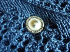Decorative and double-sided magnet button. Strong enough to hold through 5 layers of thin cotton, while preserving clothes.