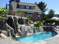 Google Image Result for http://www.ncinc.com/custom-projects/pools/grotto-waterfall-slide-bremerton/images/splash.jpg