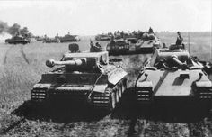 Numbers of Tiger 1 tanks along with several Panther V Ausf D's operating with the Pz.Abt.51 diring in the build up for Operation Zitadelle