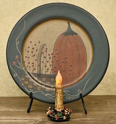 This popular Pumpkin Plate features the expressive artwork of folk artist Donna White. With its beautiful fall design, the wood plate will set the tone for your autumn home decor. It will look wonderful on an entryway table, a buffet, or a shelf. Primitive Plates, Primitive Fall Crafts, Primitive Autumn, Autumn Crafts, Primitive Decor, Country Primitive, Halloween Banner, Fall Halloween, Halloween Plates