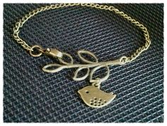 Antiqued Vintage Bronze Leaf with Bird Charms by LaLaCrystal, $20.50