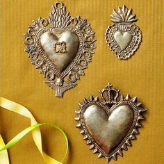 Milagros from Wisteria, set of 3 for around thirty dollars. and high spiked heart is great Heart In Nature, Heart Art, Religious Icons, Religious Art, Memento Mori, Beaded Beads, My Funny Valentine, Valentines, Metal Embossing
