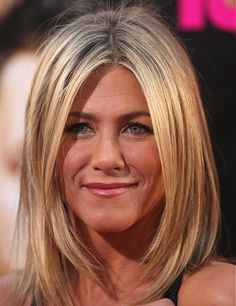 A long blonde straight coloured multi-tonal Jennifer Aniston blonde Womens haircut hairstyle by Celebrity Hairstyles