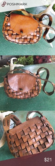 """Vintage woven leather handbag Great vintage leather handbag, it has a thick leather weave. Nice condition with little wear. Great for fall!!!!  9 1/2"""" wide ➡️7"""" long⬇️strap is 29"""" long(hits at the waist) Vintage Bags Shoulder Bags"""