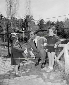 Reputed mobster Lucky Luciano chats with children in Rome's zoo, April 19, 1949.