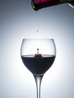 Kurtis Lamberton Photography - Wine dripping into glass.
