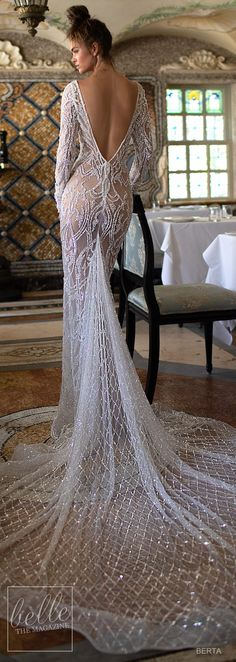 fitted embellished wedding dress. Illusion deep plunging back mermaid bridal gown with chapel train. #weddingdress #weddingdresses #bridalgown #bridal #bridalgowns #weddinggown #bridetobe #weddings #bride #weddinginspiration #dreamdress #fashionista #weddingideas #bridalcollection #bridaldress #fashion #bellethemagazine #ido #getthelook #dress See more gorgeous bridal gowns by clicking on the photo