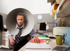 people wearing dog cones | An angry and stressed businesman, in his cubicle, wears a dog cone ...