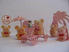 A Bundle of Vintage Pink Teddies in Metal Settings