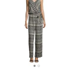 HP NWT'S Romeo & Juliet Couture jumpsuit. Work Week Chic Host Pick 4/25NWT's Romeo & Juliet Couture multi-patterned relaxed fit rayon jumpsuit. Beige/ Black. Approx. 62 inches long from shoulder to hem. Surplice neckline with wide shoulder straps. Elasticized waist with tie detail. Made in USA- hand wash. Size guide: Large=12-14, Bust 37.5-39 inch, waist 29-30.5 and hip 39.5-41 inches Romeo & Juliet Couture Pants Jumpsuits & Rompers