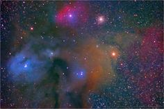 The Antares - Rho Ophiuchi Region in Scorpius is one of the most beautiful and colorful areas of the entire night sky.    It contains dark nebulae where lanes of obscuring dust hide background stars, blue reflection nebulae where the dust is illuminated by the reflected light of nearby stars, and red emission nebulae where the hot hydrogen gas itself is glowing and emitting light.