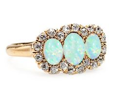 Antique Opal Diamond Cluster Ring .love this!!