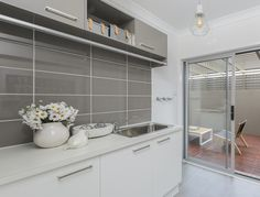 Grey subway tiles laid stackbond for a clean and simple look as seen in the Allworth Trenton display home. Contemporary Kitchen Backsplash, Kitchen Tiles, Kitchen Design, Grey Subway Tiles, Splashback Tiles, Kitchen Clocks, Kitchen Remodel, Kitchen Reno, Living Room Designs