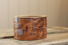 This leather cuff includes ONE blank shape of your choice. Cuff is 1 1/2 wide.     TO ORDER  Choose blank shape from drop down menu then leave