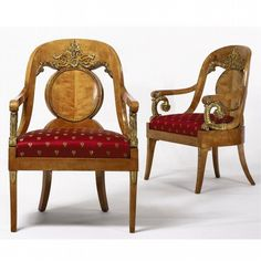 A PAIR OF RUSSIAN NEOCLASSICAL KARELIAN BIRCH PARCEL GILT ARMCHAIRS CIRCA 1830<br><br>CIRCA 1830<br><br><B>measurements</B><br>height 39 1/2 in.; width 26in.<br><br><B>alternate measurements</B><br>(100.3cm; 66cm)<br><br>PROVENANCE<br><br>As per previous lot.