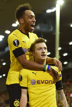 Marco Reus Photos Photos - Marco Reus of Borussia Dortmund celebrates scoring his team's third goal with Pierre-Emerick Aubameyang during the UEFA Europa League quarter final, second leg match between Liverpool and Borussia Dortmund at Anfield on April 14, 2016 in Liverpool, United Kingdom. - Liverpool v Borussia Dortmund - UEFA Europa League Quarter Final: Second Leg