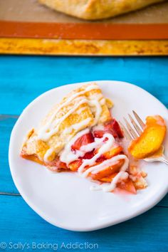 Rustic Strawberry Peach Tart - the juiciest fruits settled inside a buttery, flaky crust. This free-form dessert is so easy to make! Recipe @ sallysbakingaddiction.com