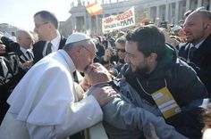 Blessing a disabled gentleman .... thats our pope!