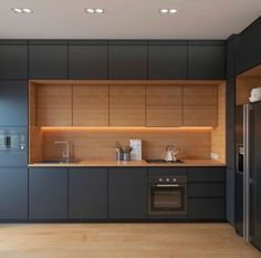 Contrast timber lined alcove set in dark joinery