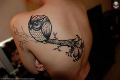 This is a tattoo of an owl on a branch that has been tattoo'd on some ones back. I like this image as the camera angle is more flattering to see all of the tattoo at different levels and the tattoo itself is realistic.