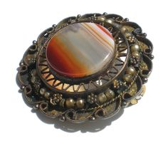 Striped Agate Pendant Brooch on Sterling Silver Ornate Filigree Style Workwork - Made in Israel Vintage Jewelry by RibbonsEdge on Etsy https://www.etsy.com/listing/522443106/striped-agate-pendant-brooch-on-sterling