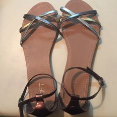 Ann Taylor loft metallic flat sandals 10 Ann Taylor loft metallic flat sandals 10. Has silver, gold, and a rosy bronze. Only once for a few hours perfect condition. A really versatile shoe! Too big for me. LOFT Shoes Sandals