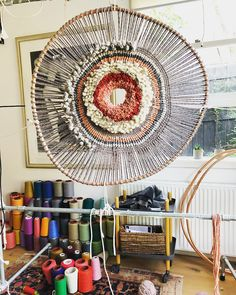 "Tammy Kanat creates textile art that's larger than life. Her colorful, highly-textural wall hangings feature organic circular and oval shapes that are a celebration of materials. ""For me,"" she says, ""weaving projects a mood. Loom Weaving, Tapestry Weaving, Circular Weaving, Arts And Crafts, Diy Crafts, Textile Fiber Art, Textiles, Weaving Projects, Woven Wall Hanging"