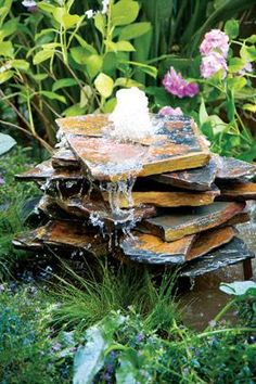 This water feature is very easy to build and you can tailor it to suit your own space and style. http://www.homeplace.co.za/solutions/100013_slate-water-feature.php
