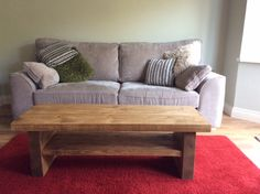 Our 2 Leg Coffee Table, but with a shelf. This option isn't yet available online, contact us for more info!