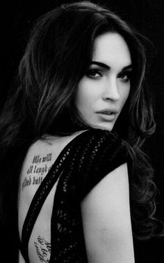 If I could be anyone, it would be Megan Fox. She has great style, great hair, an AMAZING body, she's gorgeous, covered in tattoos and she has the mouth of a sailor ;) I LOVE HER!
