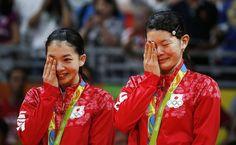 Ayaka Takahashi (R) and Misaki Matsutomo of Japan (L) celebrate their gold…