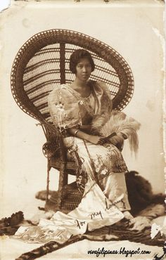 Vintage wicker throne. Life in the Phillipines back in the day. Love this.