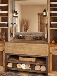 Rustic Master Bathroom with stone backsplash, European Cabinets, Wall sconce, Farmhouse Sink, Flat panel cabinets, Flush