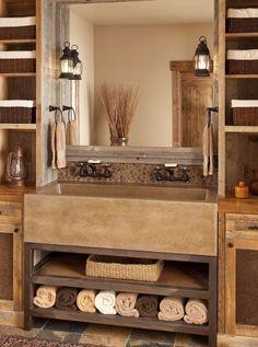 Rustic Master Bathroom with stone backsplash, European Cabinets, Wall sconce, Farmhouse Sink, Flat panel cabinets, Flush