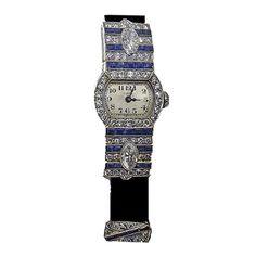 Art Deco Platinum, Diamond and Sapphire Wristwatch by Ellis Bros and Zenith. Circa 1920s