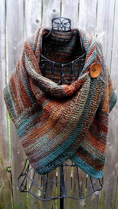 Buttoned wrap made with multiple colored yarn that reminds me of the colors of Arizona. Large brown button is used to button wrap at the upper