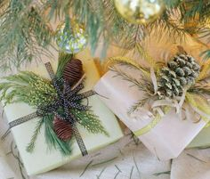 Greenery, pinecones and polka-dot ribbon wrap up these gifts with natural style.