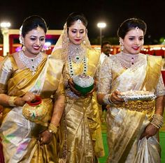 Image may contain: 3 people, people standing Wedding Saree Collection, Bridal Collection, Bridal Blouse Designs, Saree Blouse Designs, Indian Bridal Outfits, Fancy Sarees, Silk Sarees, Saris, South Indian Bride