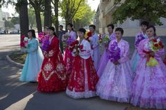 Illuminating North Korea - The New York Times: Women before a march calling for peace and the reunification of Korea